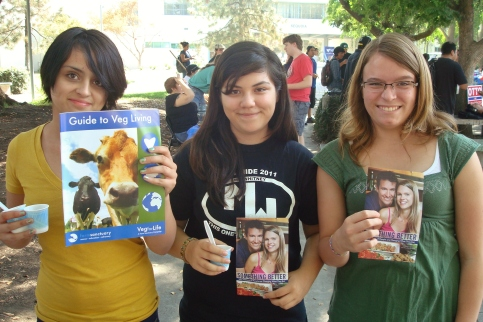 Students receiving vegan literature at College of the Sequoias.